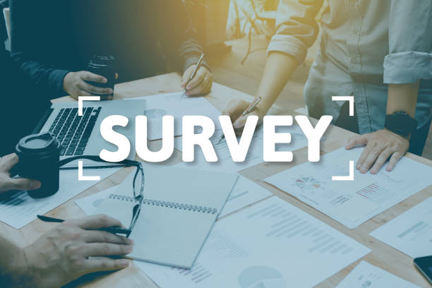 Group of entrepreneurs analysis and enjoy working survey concept in productive environment. stock photo