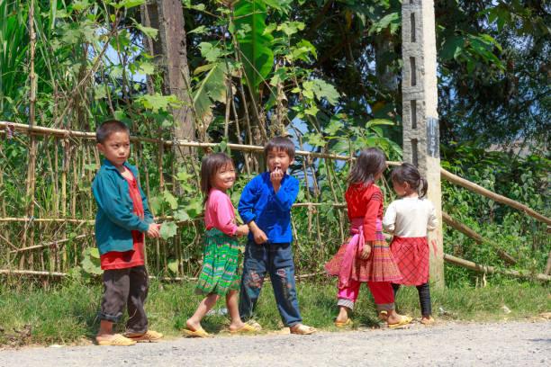 group of ethnic minority children congregate outdoor in hoang su phi, ha giang province, vietnam - minority stock photos and pictures