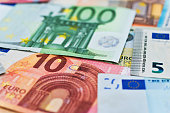 istock Group of euro bills background 957641902