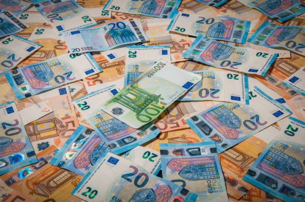 group of euro money banknote: 20 euro 50 euro 100 euro banknote: 20 euro 50 euro 100 euro thrown on the ground fifty euro banknote stock pictures, royalty-free photos & images