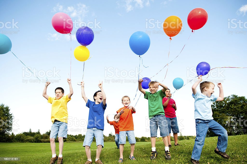 Group of Excited Boys Jumping and Celebrating Outside royalty-free stock photo