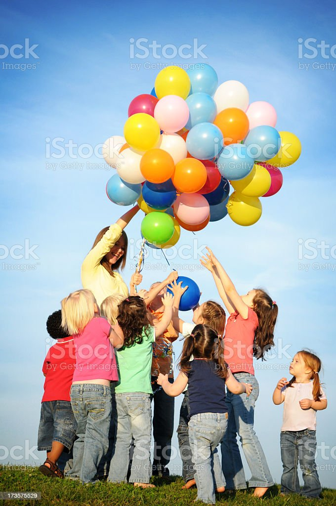 Group of Excited Children Reaching for Balloons royalty-free stock photo