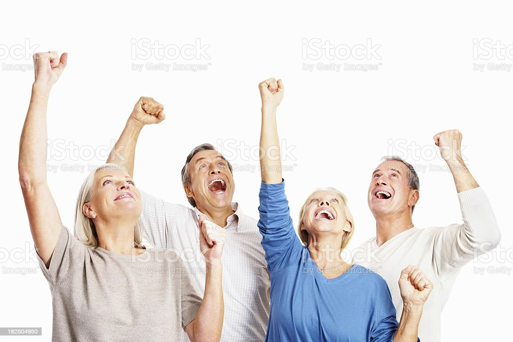 Group of excited senior people raising hands in joy royalty-free stock photo