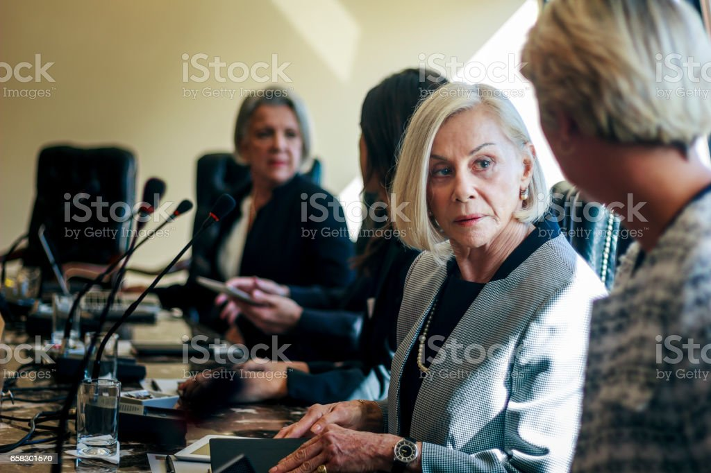 Group of executive people working on a conference room stock photo