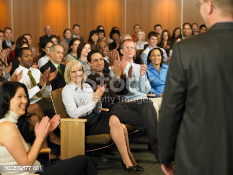 862720340 istock photo Group of executives applauding for man leading seminar in auditorium 200529577-001