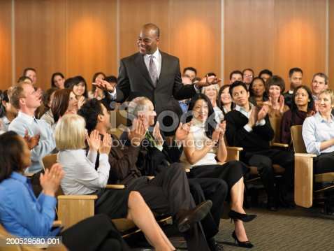 862720340 istock photo Group of executives applauding for man leading seminar in auditorium 200529580-001