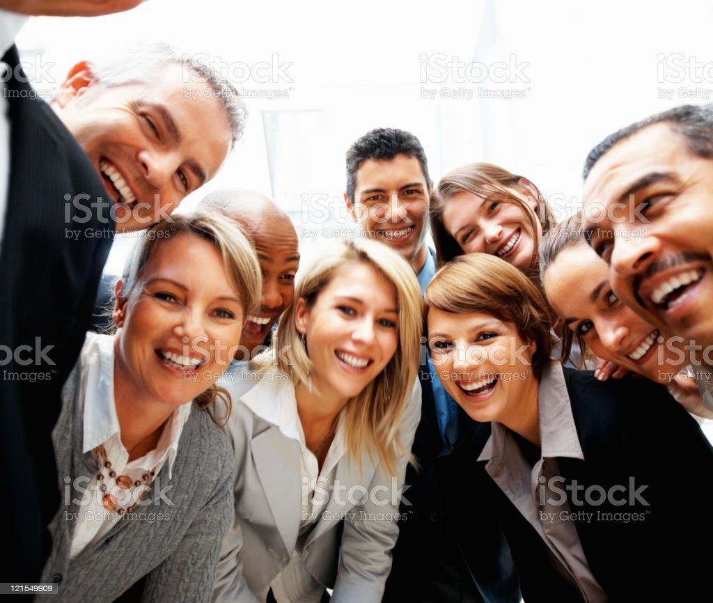 Group of executives laughing and smiling royalty-free stock photo