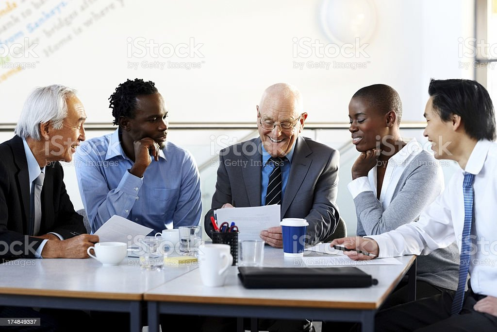 Group of executives meeting around a table royalty-free stock photo