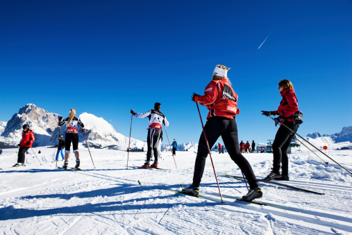 istock group of exercising winter sport athletes skiing on Seiser Alm 478218377