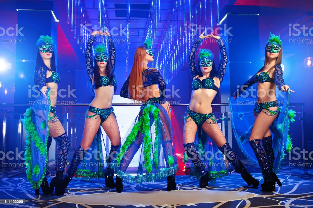 Group of exotic dancers wearing colorful stage carnival outfits stock photo