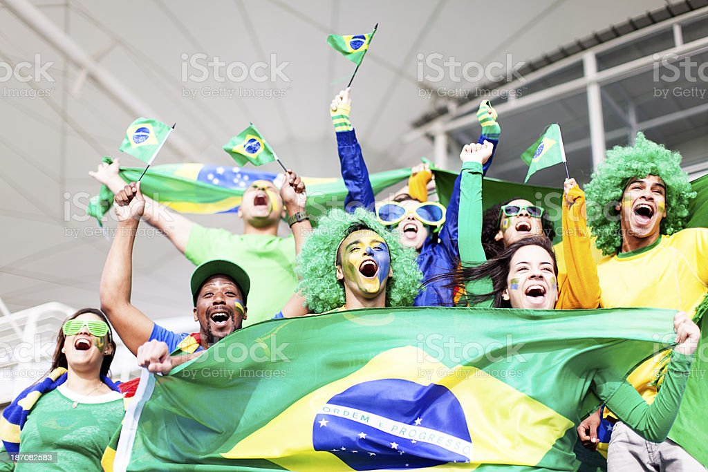 Group of fans cheering Brazil at a Football Match stock photo