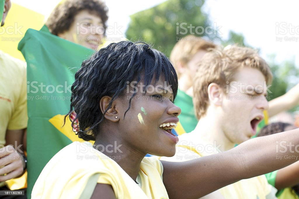 Group of fans cheering royalty-free stock photo