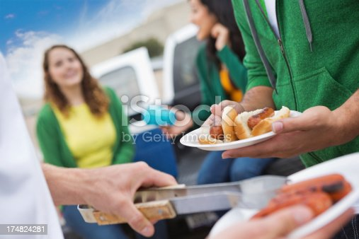 istock Group of fans having tailgating cook out at football stadium 174824281