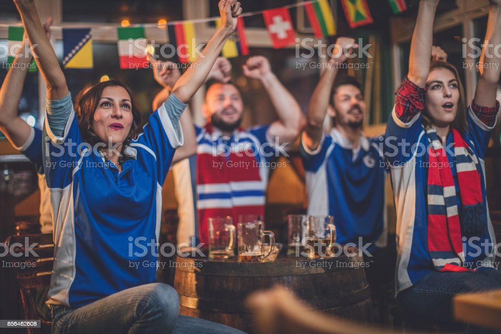 Group of fans watching their club stock photo