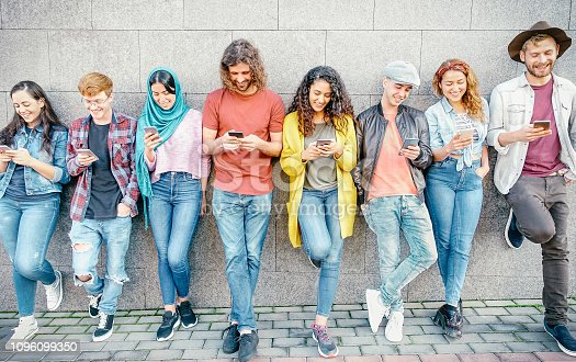 istock Group of fashion friends watching on their smart mobile phones - Millennial generation z addicted to new technology trends - Concept of people, tech, social media, friendship and youth lifestyle 1096099350