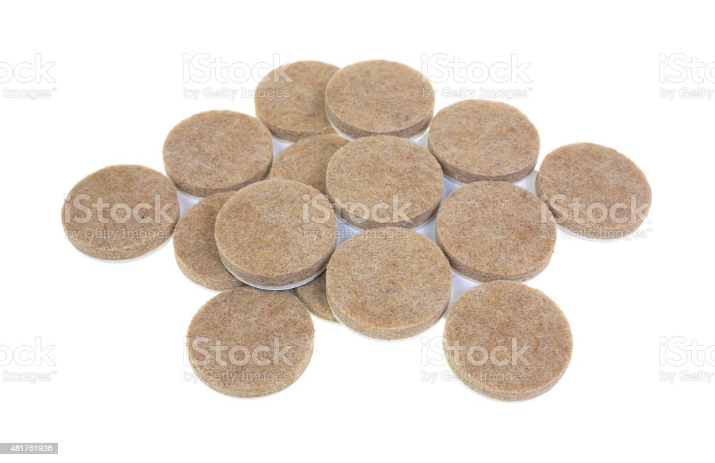 Group of felt surface protectors stock photo