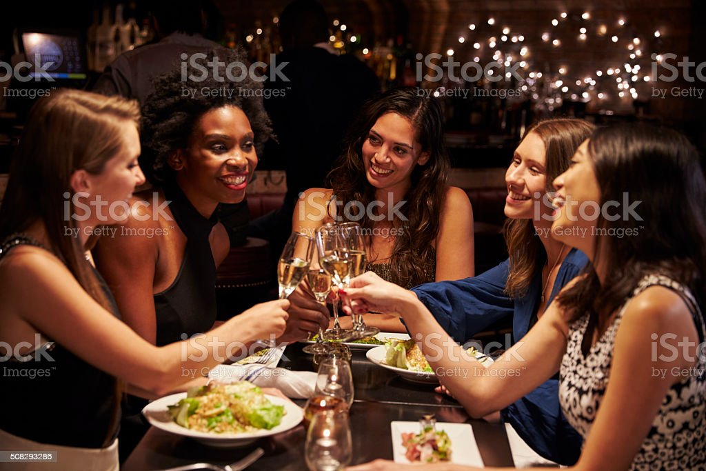Group Of Female Friends Enjoying Meal In Restaurant stock photo