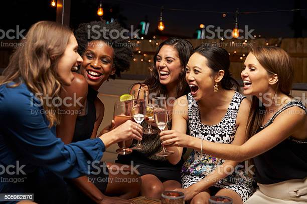 Group of female friends enjoying night out at rooftop bar picture id505962870?b=1&k=6&m=505962870&s=612x612&h=mxfxsvt991aqhsh7mav mhipcwyesdctqxuzj98lfuq=