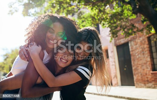 istock Group of female friends enjoying outdoors on city street 830321448