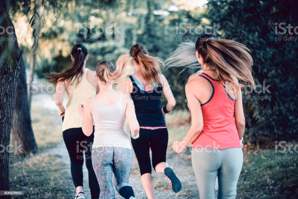 Group of Female Friends Jogging in the Mountain Nature stock photo