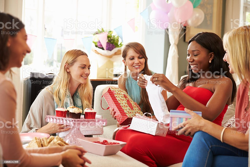 Group Of Female Friends Meeting For Baby Shower At Home​​​ foto