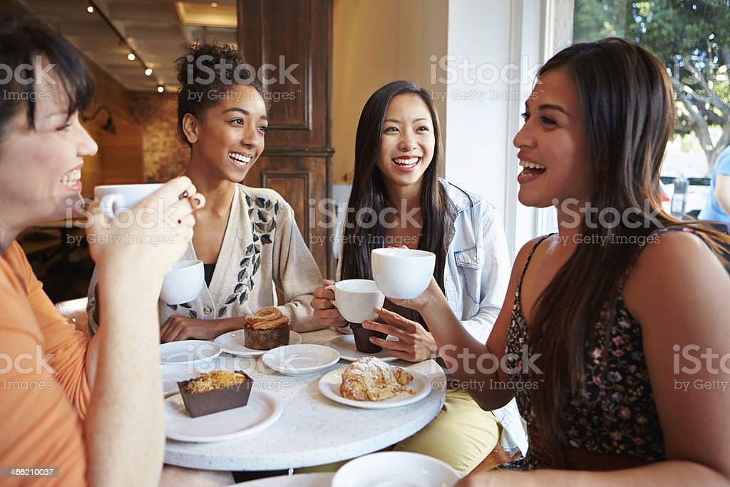 Group Of Female Friends Meeting In Café Restaurant stock photo