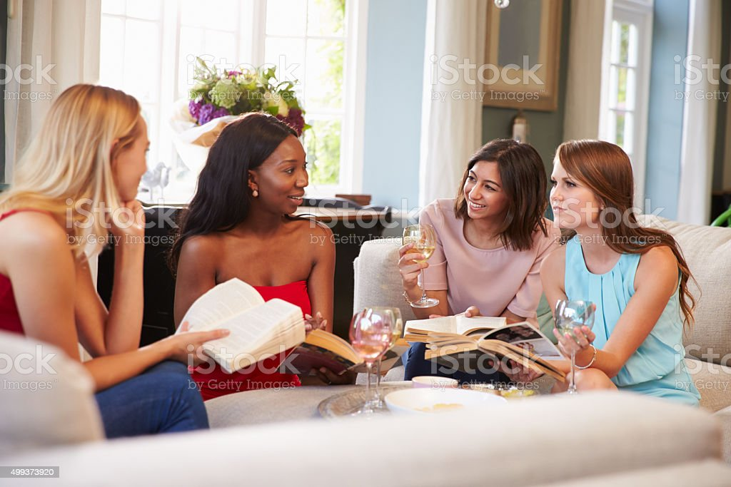 Group Of Female Friends Taking Part In Book Club stock photo