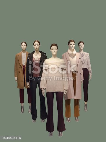 Group of female mannequins wear fashionable clothes, isolated. No brand names or copyright objects.