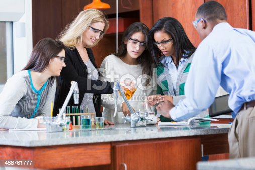 129300487 istock photo Group of female students in science class with male instructor 488761777
