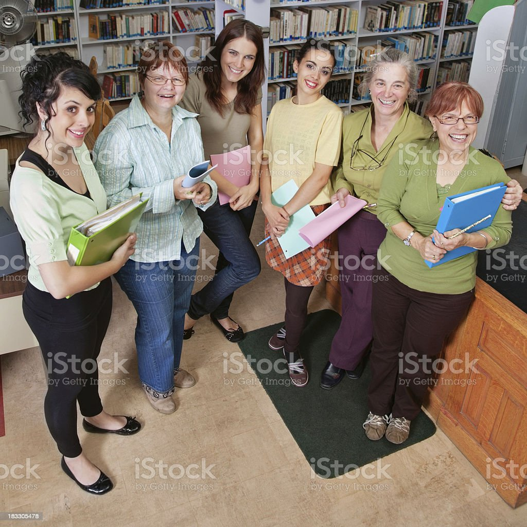 Group of Female Women Posing in The Library royalty-free stock photo