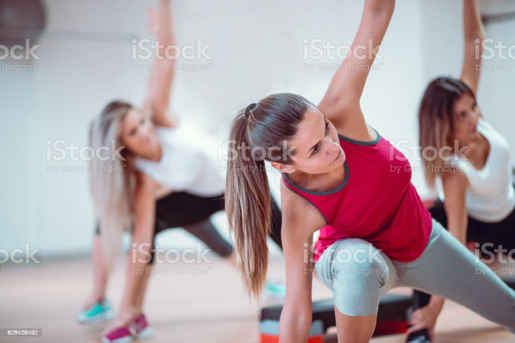 Group of Females Stretching in Gym Before Aerobics Training stock photo