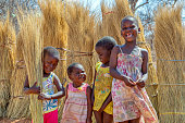 istock Group of few happy girls and a boy playing 1186785291