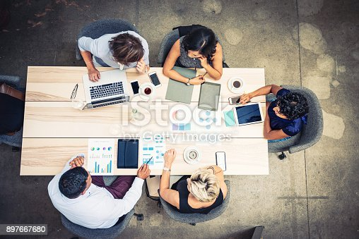 istock Group of financial professionals analyzing markets 897667680