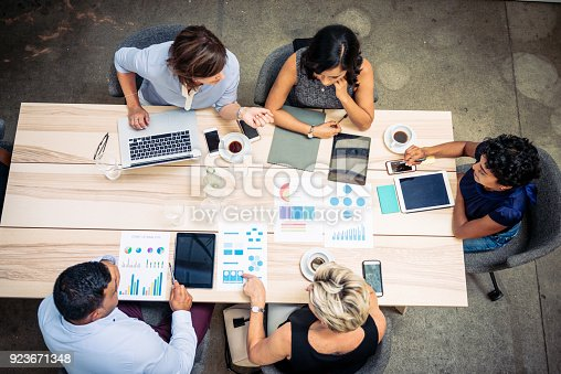 istock Group of financial professionals preparing tax paperwork 923671348
