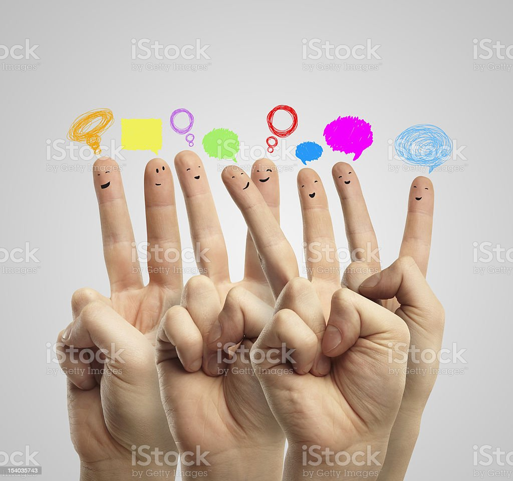 A group of fingers with smiley faces with social graphics stock photo
