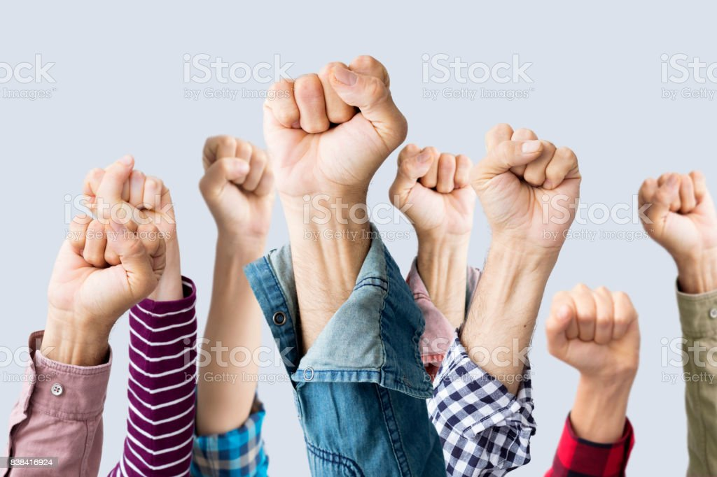 Group of fists raised in air stock photo