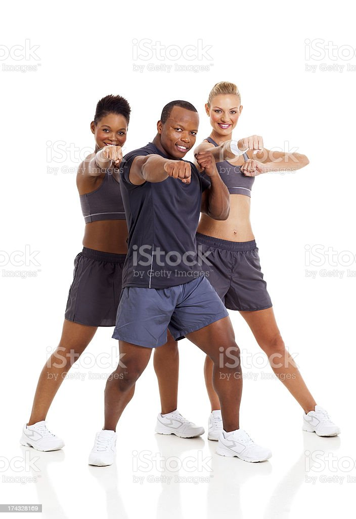 group of fit young adult working out stock photo