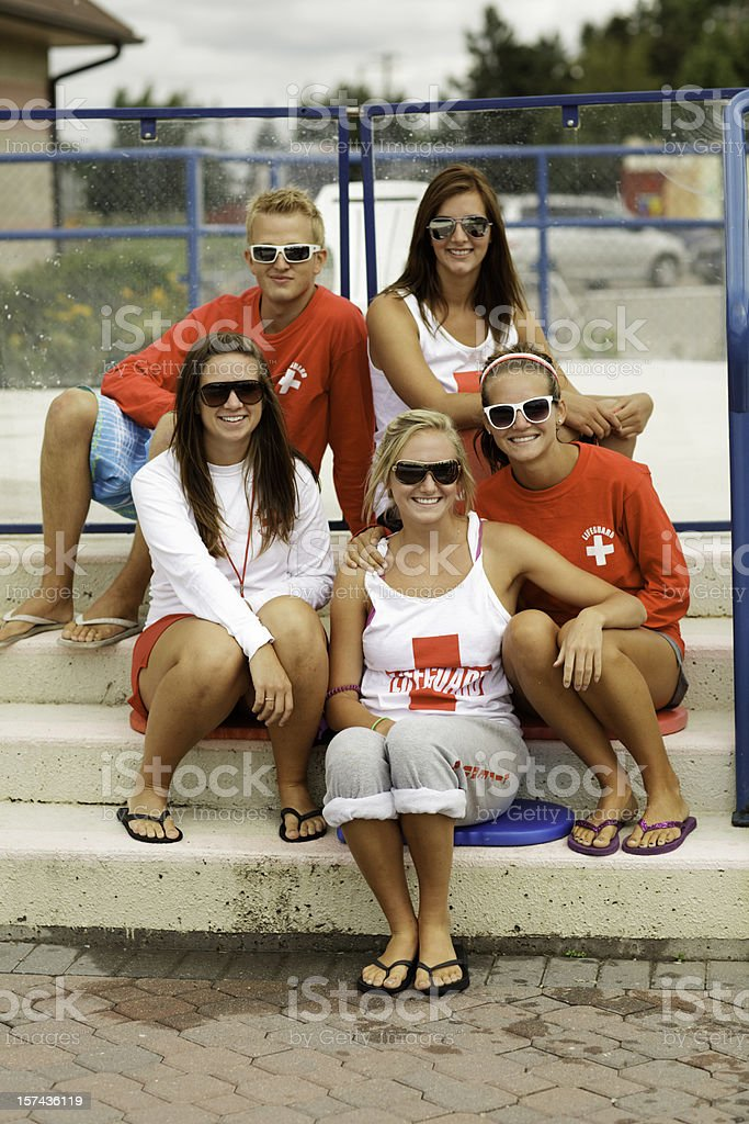 A group of five lifeguard friends stock photo