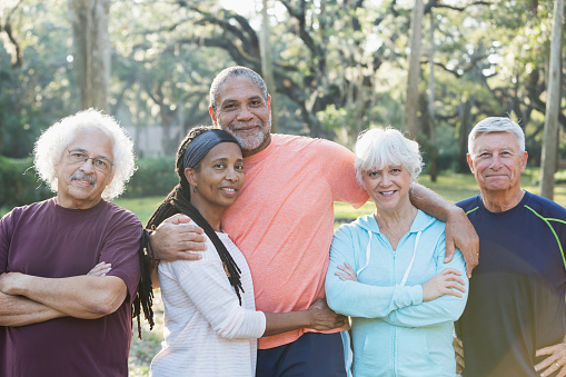 Group Of Five Multiethnic Seniors Standing In Park Stock Photo - Download  Image Now