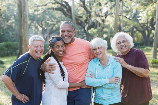 istock Group of five multi-ethnic seniors standing in park 823634630