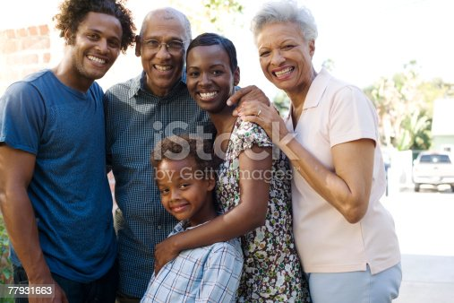istock Group of five people in front of house 77931663