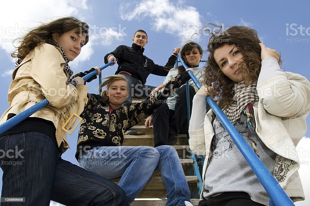 Group of five teenage people on the stairs royalty-free stock photo