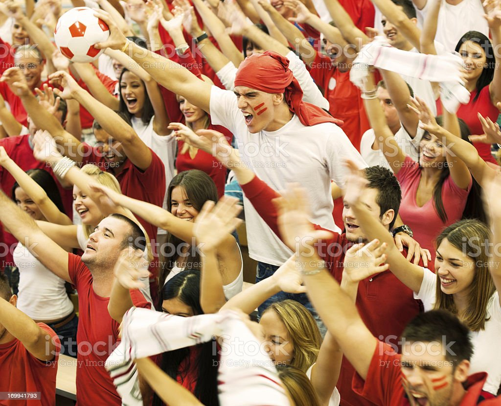 Group of football fans cheering royalty-free stock photo