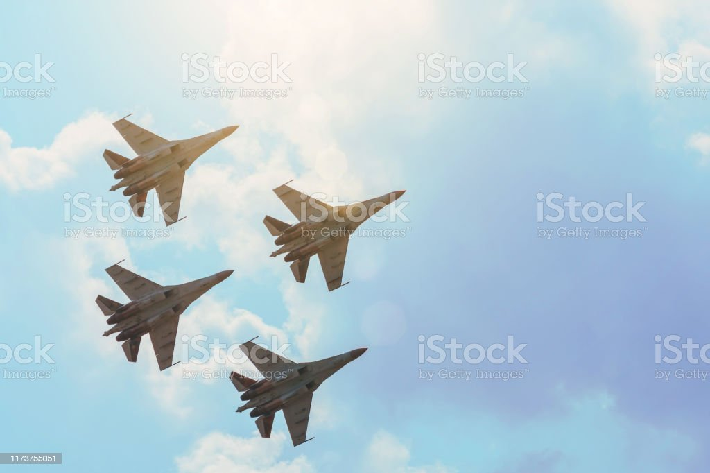Group of four aircraft fighter jet airplane sun glow toned gradient clouds sky. Group of four aircraft fighter jet airplane sun glow toned gradient clouds sky Abstract Stock Photo