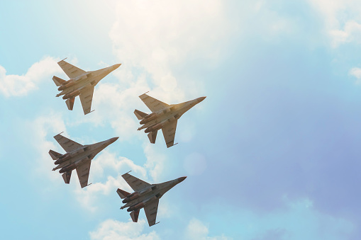 Group Of Four Aircraft Fighter Jet Airplane Sun Glow Toned Gradient Clouds Sky Stock Photo - Download Image Now
