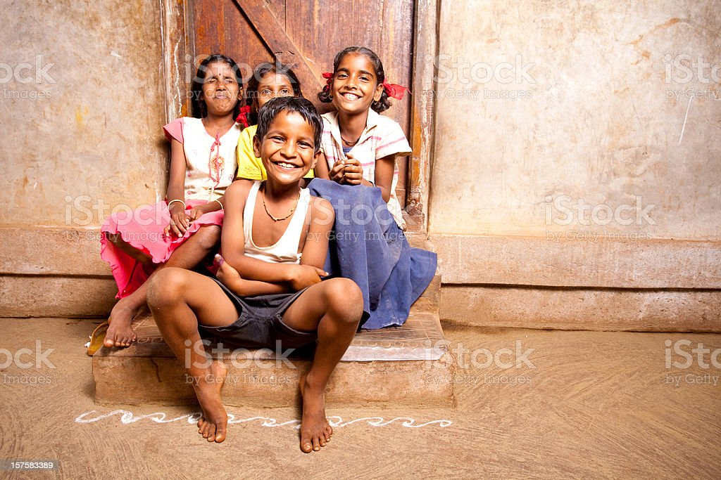 Group of four Cheerful Rural Indian Children stock photo