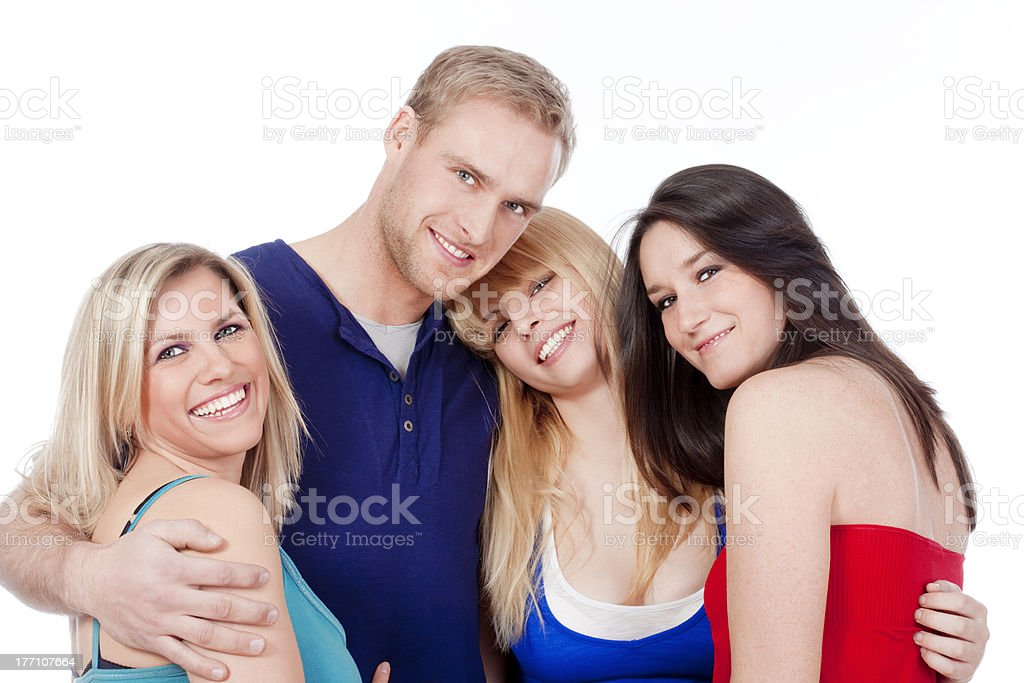 group of four friends smiling stock photo
