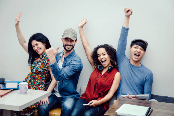 Group of four multiethnic entrepreneurs celebrating success stock photo