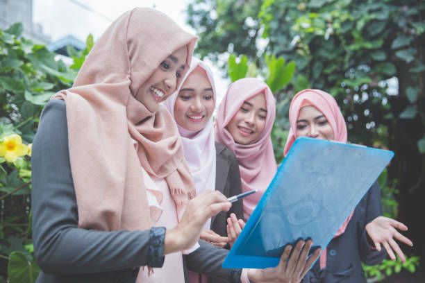 Group of four muslim business woman stock photo