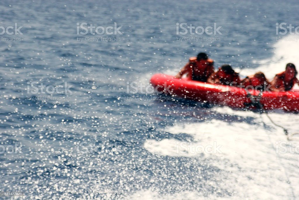 Group of four on tubes on Red sea coast. stock photo
